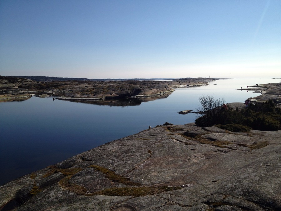 placid landscape with calm sea among smooth rocky land in slevik southern norway