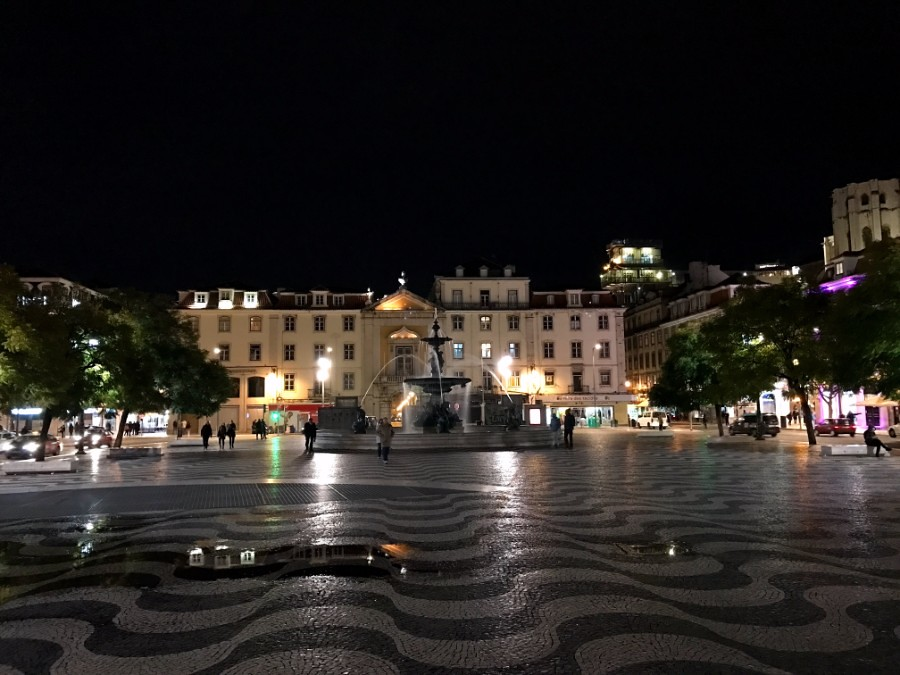 central square and fountain in lisbon at night