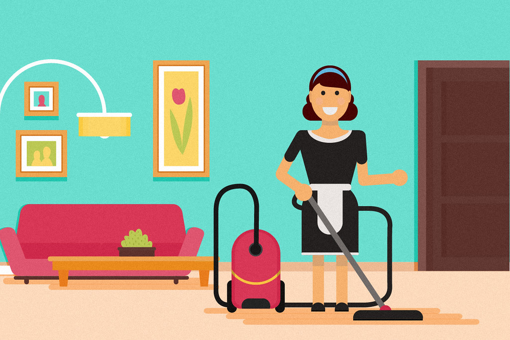 housekeeper vacuuming a living room in a home  An