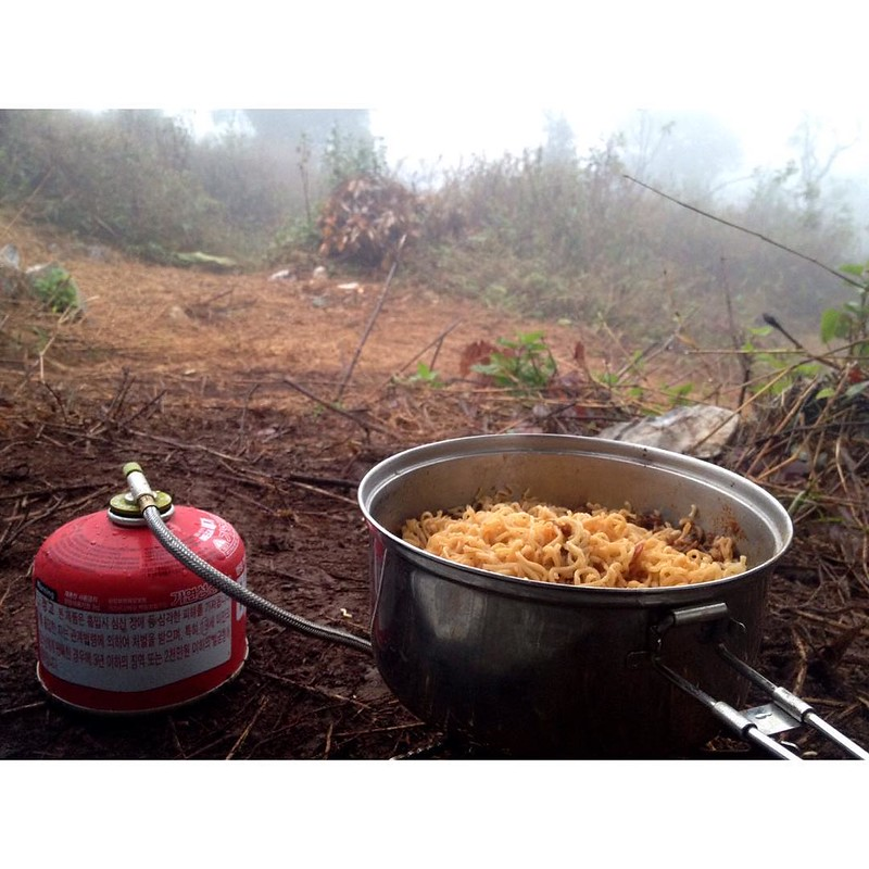 preparing noodles on gas stove in doi chiang dao mountain