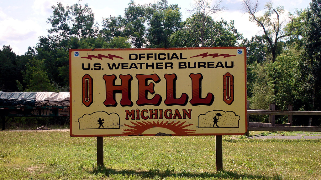 Sign on County highway D-32 in Hell, Michigan, United States, locating the official U.S. weather station in Hell. June 22, 2007
