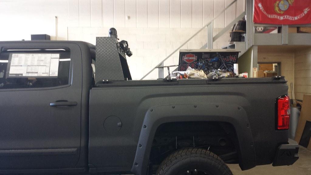 A Heavy Duty Cover With Custom Headache Rack On A Chevy Gm