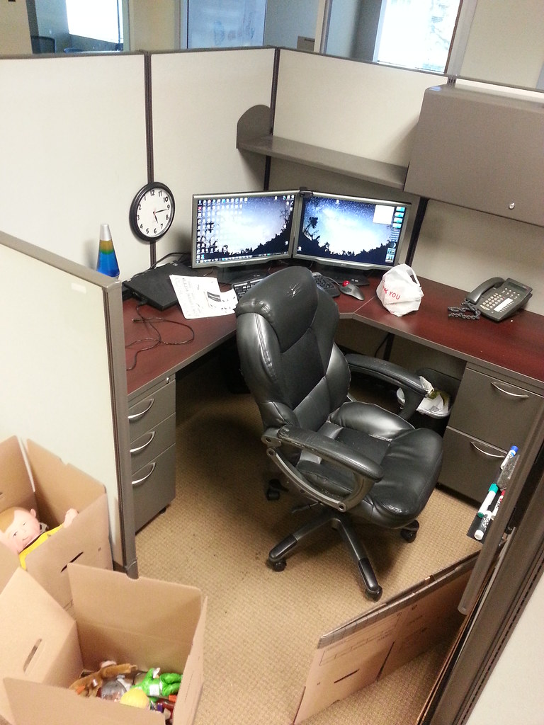 Packing up my desk Saying goodbye to my cubicle tonight