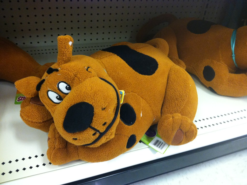 A comfy Scooby Doo pillow that is cute and soft Somethin