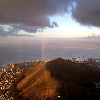 rainbow over signal hill in cape town