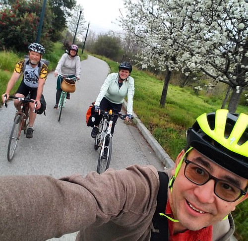 Riding through plum blossoms with San Jose Bike Train.  San Jose trails users: city crews are now clearing mud from under Hwy 101 on the Guadalupe River Trail so please slow down and follow their instructions.   #commutebybike #bikecommute #commute #cycli