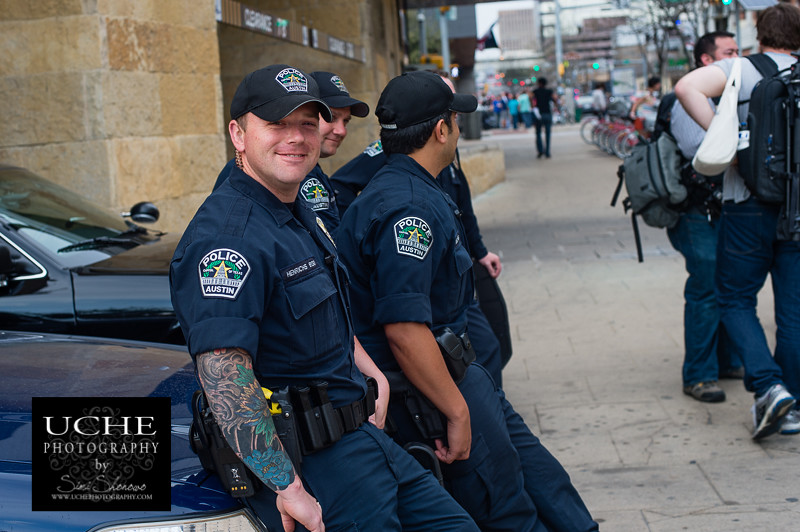 tatted cop smiles