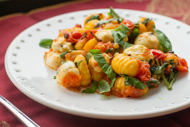 Pan-fried gnocchi with oven-roasted tomatoes, fresh basil, and mozzarella - perfect for a little indulgence or date-night meal!