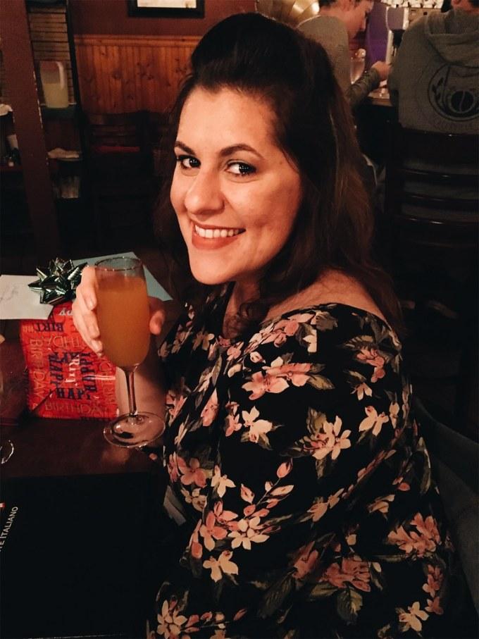 Enjoying a Peach Bellini at my birthday dinner