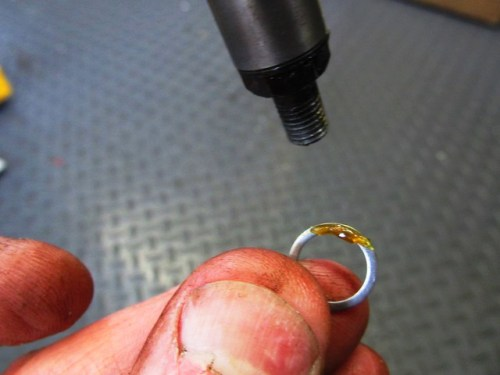 Dap of Grease To Hold Small Aluminum Washer On Bottom of Damper Rod