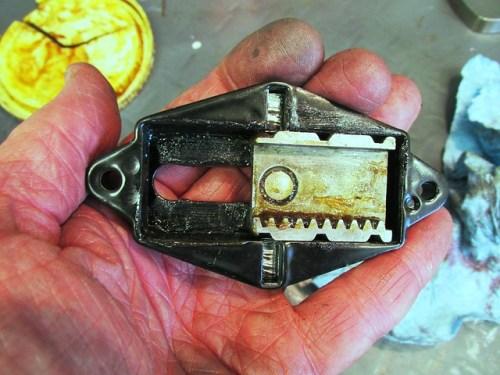 Rack Plate Installed In Steering Damper Cover