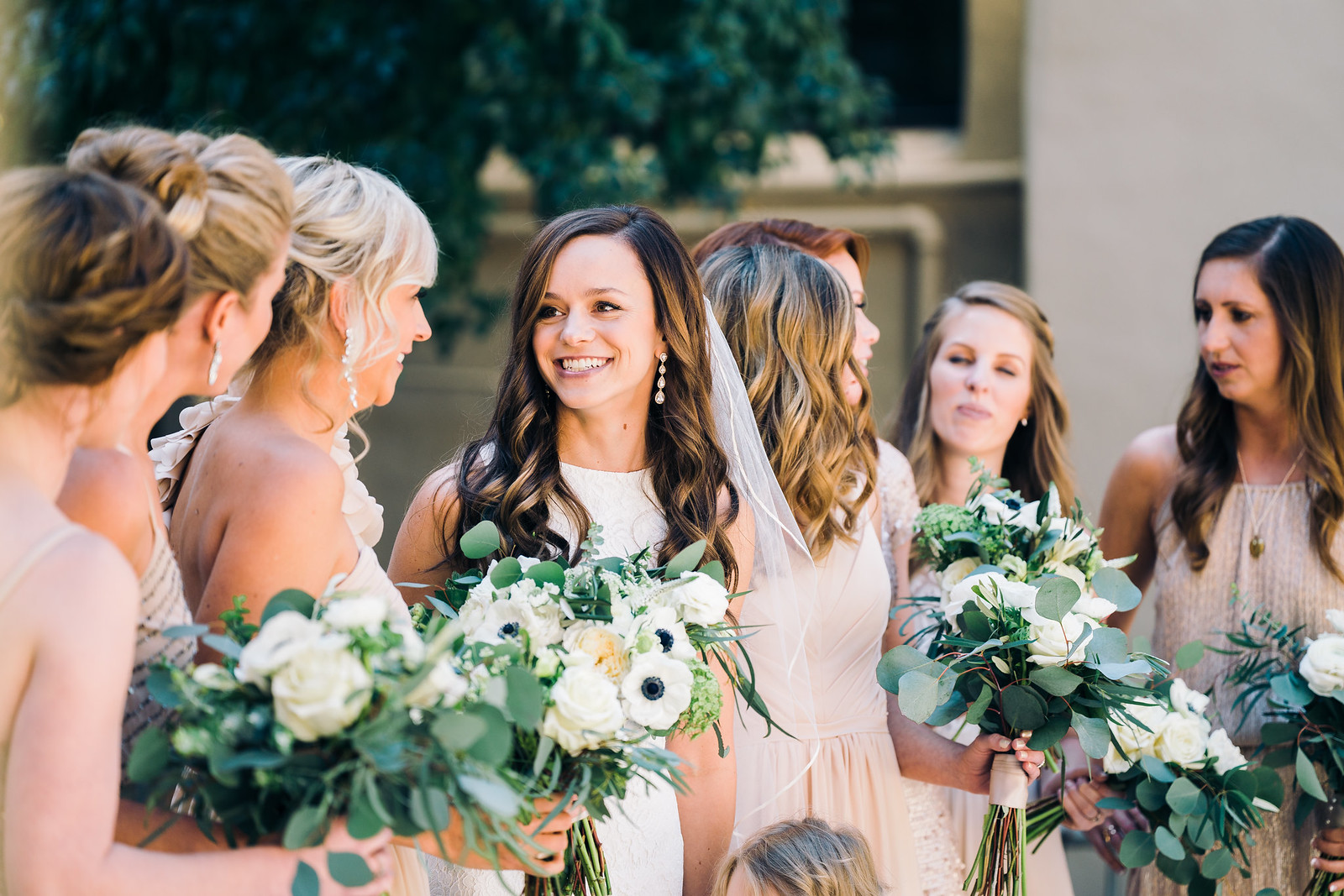 Happy bride with her bridesmaids