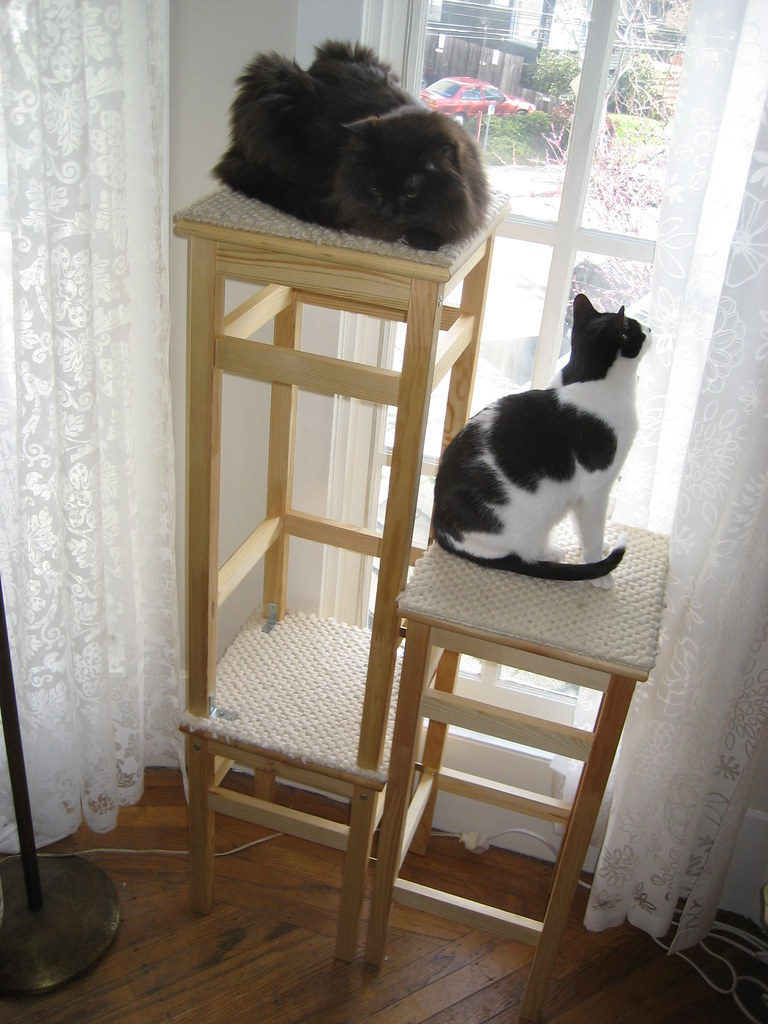 ikea hack cat tower  three stools  carpet samples  a