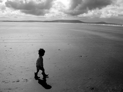 Im Alone Quotes Wallpaper Hd Child Walking Alone On A Beach Pembrey Wales My