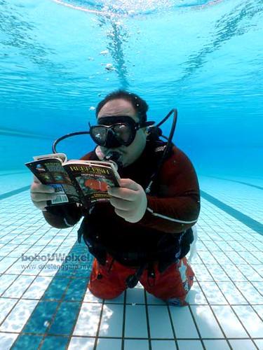 Im reading a book underwater  bobodivetenggara  Flickr