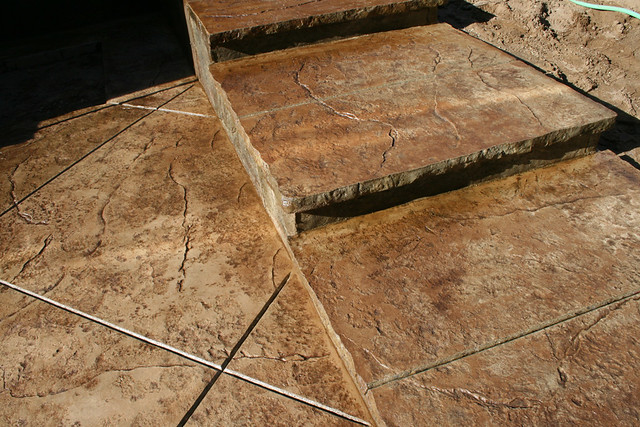 Seamless Stamped Concrete patio and steps with rough grani