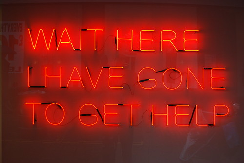 Wait here I have gone to get help  Neon message by Tim