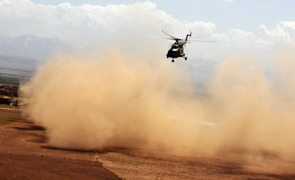 An Afghan National Army Air Corps helicopter causes a dust  Flickr