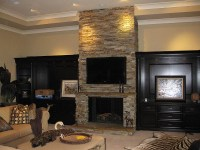 Natural ledgerstone indoor fireplace with one piece stone