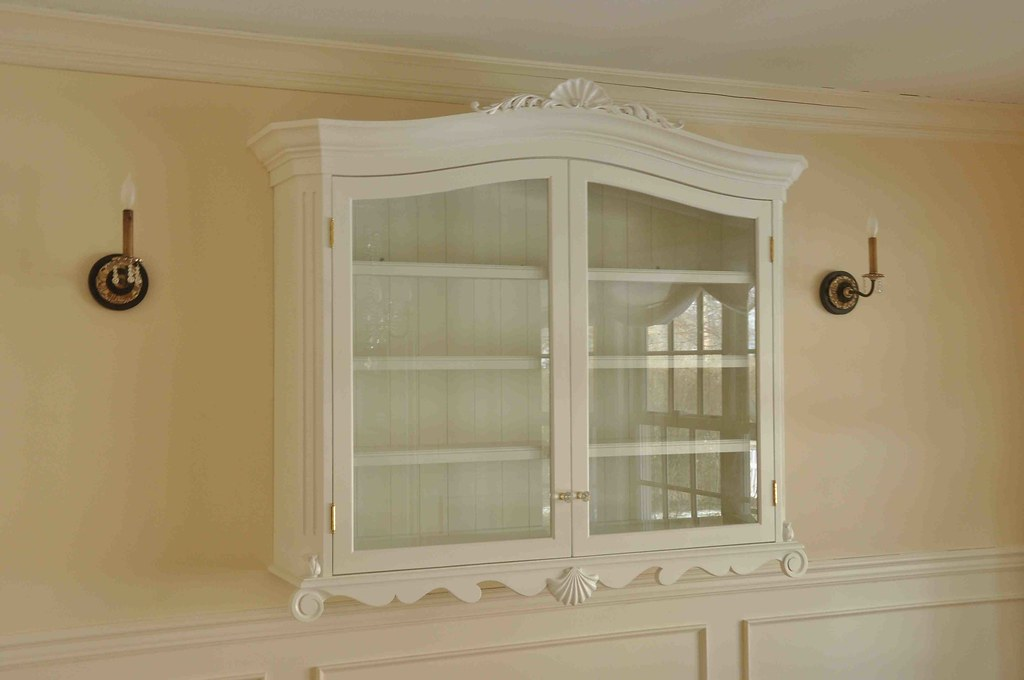 chinacab1  A wall mounted china cabinet featuring hand