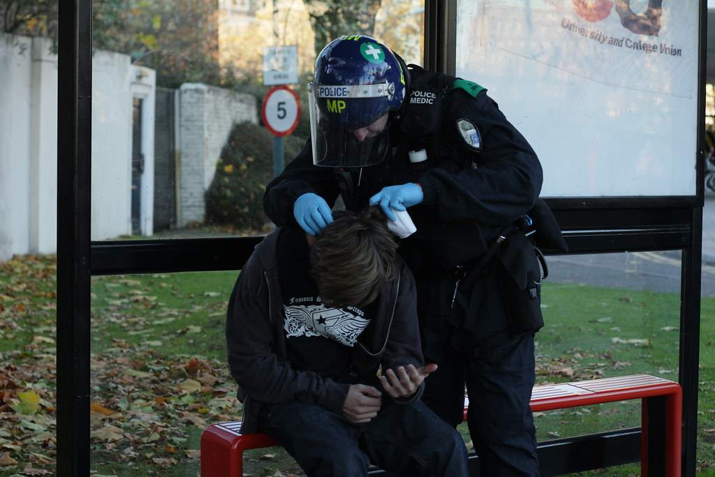 Police Medic  A police medic treats an injured