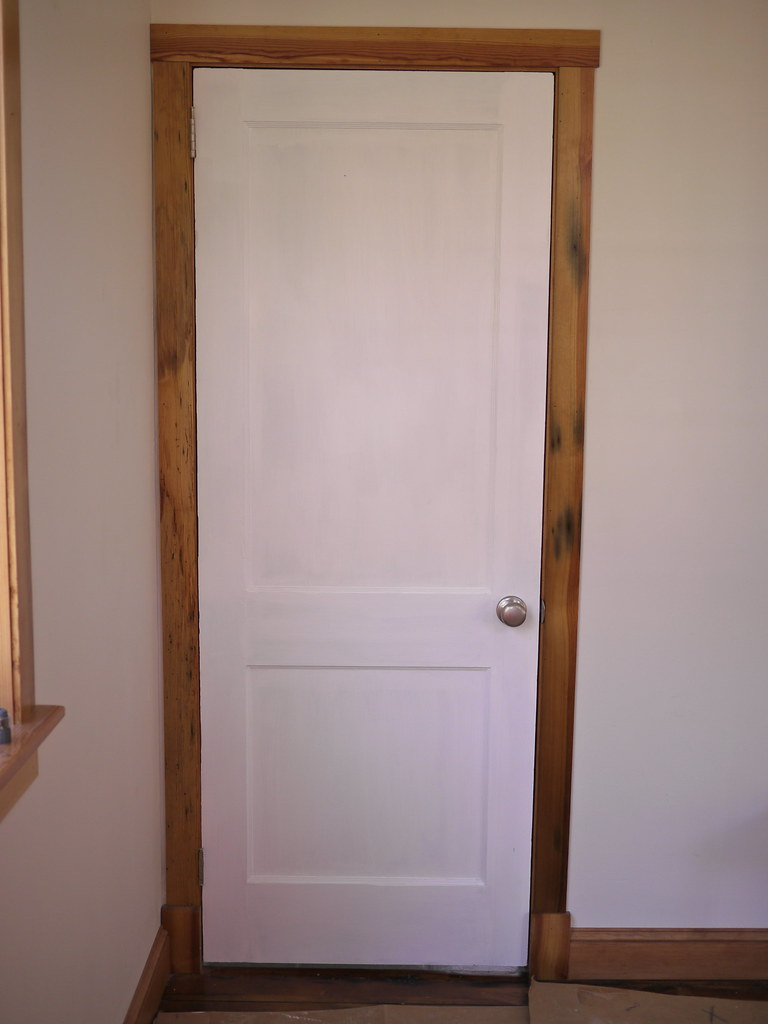 hear pine door trim bathroom  the door is antique solid