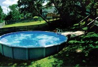 Above ground pool in sloped backyard   Swimming pool ideas ...
