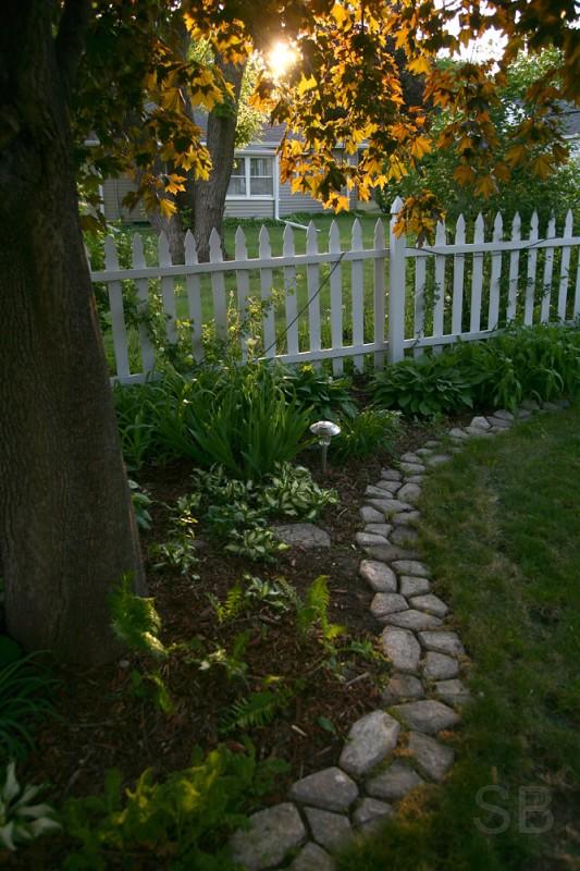 white picket fence in backyard