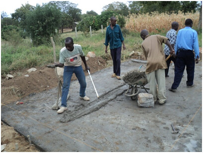 Trainees laying the blinding layer before laying the stone