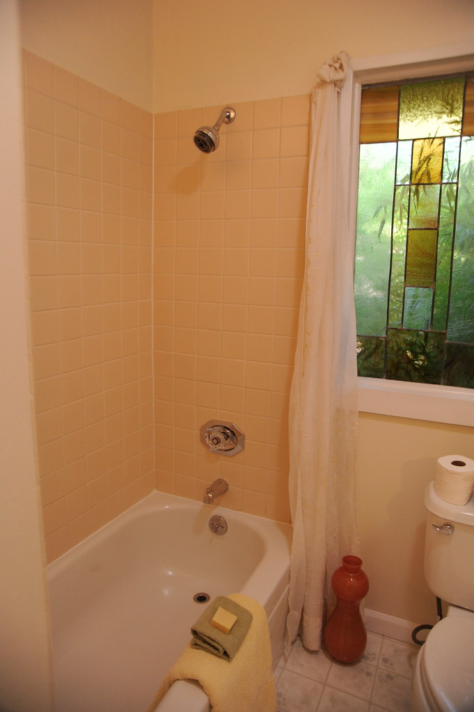 Yellow tile white shower and tub staged house towel so  Flickr