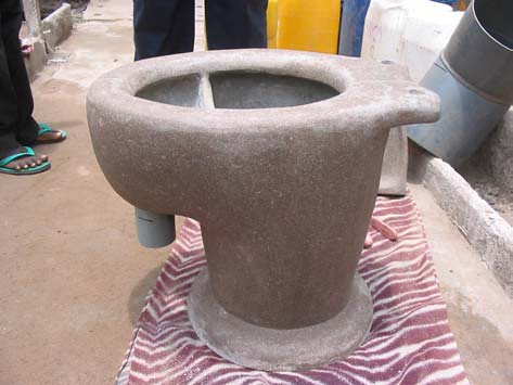 Handmade separation dry toilet from concrete  Photo by W