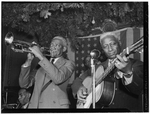[Portrait of Bunk Johnson, Leadbelly, George Lewis, and Alcide Pavageau, Stuyvesant Casino, New York, N.Y., ca. June 1946] (LOC)