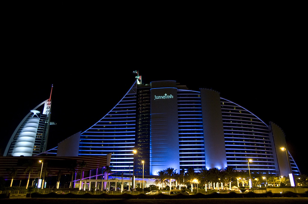 Jumeirah Beach Hotel  JBH by night as well as Burj Al