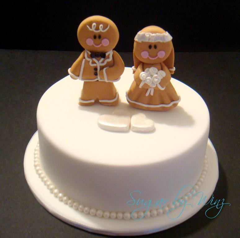 Gingerbread Men Toppers Cutting Cake For A Wedding