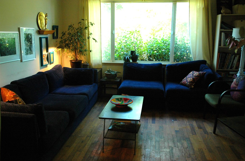 Living room blue sofas pillows wood floor 1950s metal