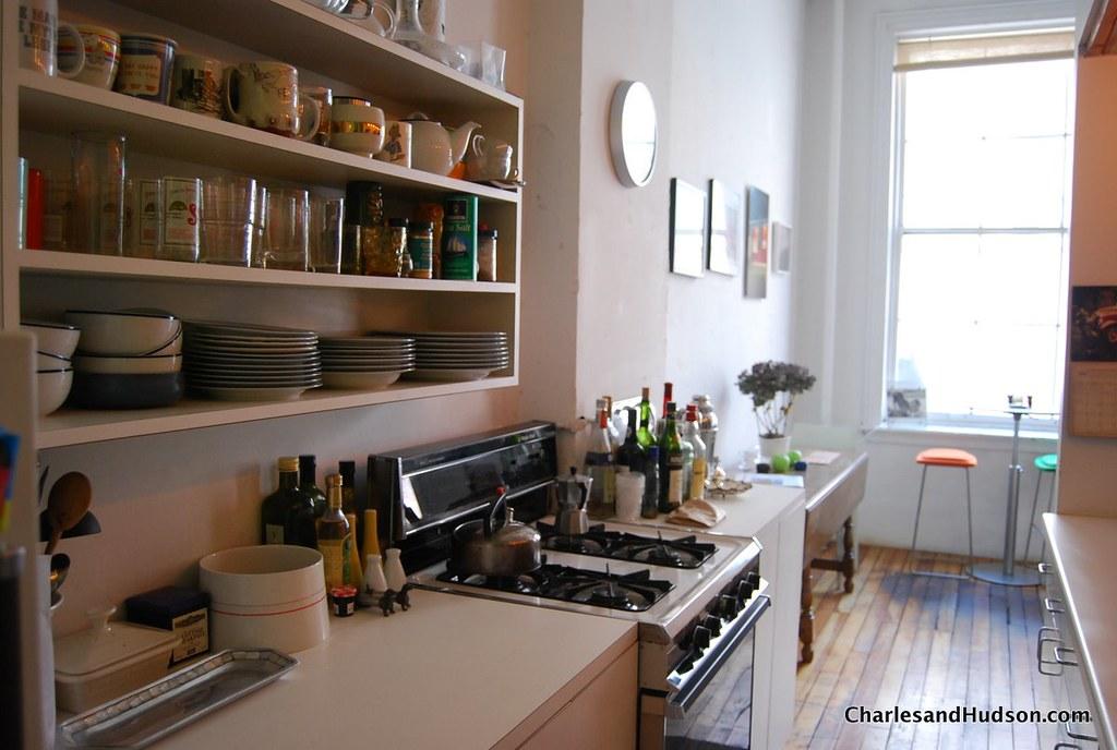 Loft Kitchen  Open shelves show off unique glasses and