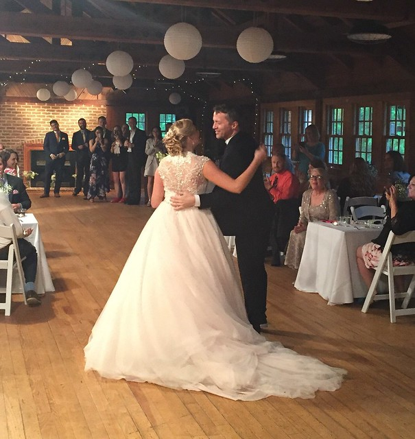 Sarah and Tim making an entrance as husband and wife at Swift Creek Hall, Pocahontas State Park Virginia