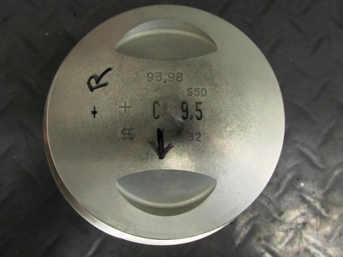 Piston Marked with Side (R-Right) and Arrow Pointing to Front