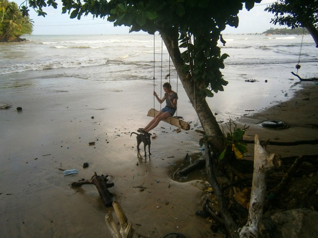 Briana On A Beach Ropeswing With A Local Friendly Dog