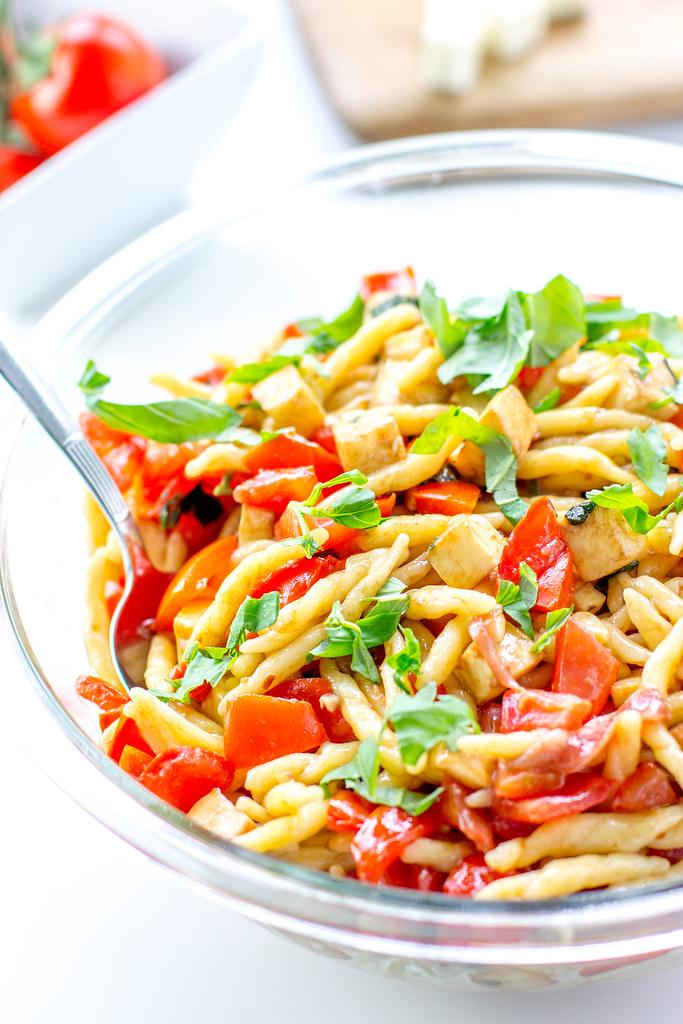 Tomato mozzarella prosciutto pasta - a light, fresh, fast summer dish.
