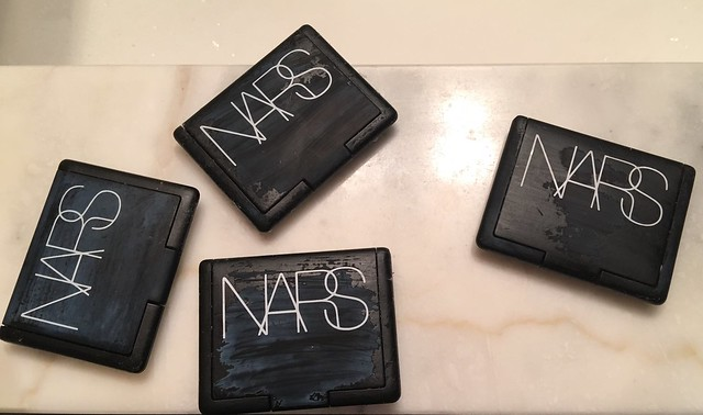 Discolored NARS compacts.