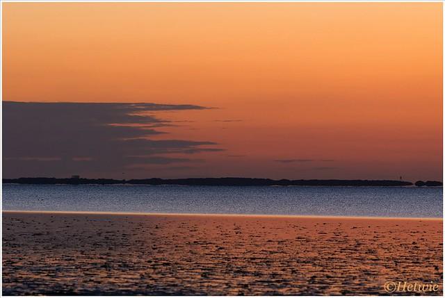 Oranje luchten als de zon net onder is.