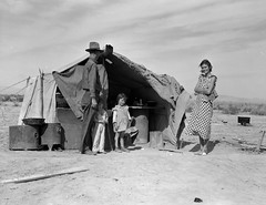 """Family of four to be returned to Oklahoma by the Relief Administration. 'They won't go until they get so hungry that there's nothing else for them to do. They won't go – not twenty-five percent will go' said a transient case worker in Imperial County. This family was hungry. They lost a two-year-old baby as the result of exposure during the winter. Holtville, California"""