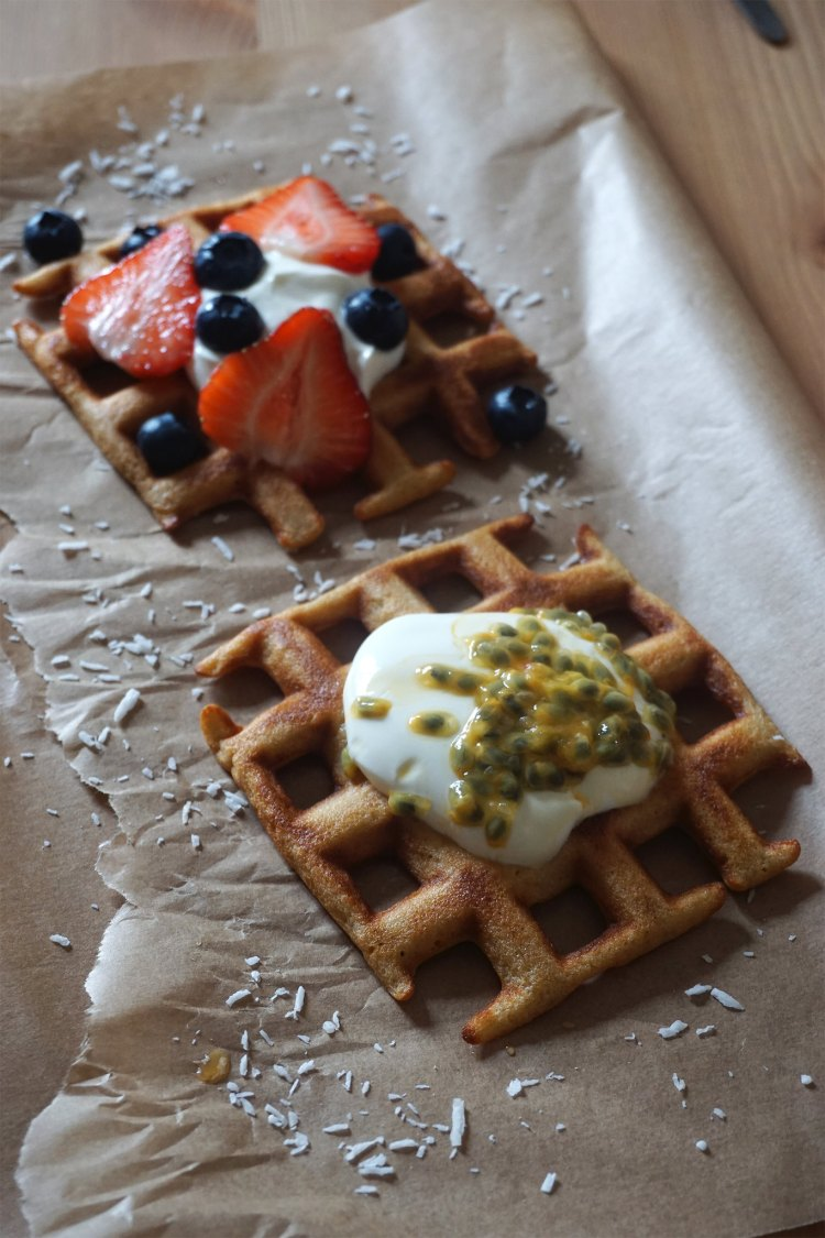 Healthy gluten free low carb coconut waffles made with Doves Farm self-raising flour and topped with Greek-style yoghurt, strawberries and blueberries