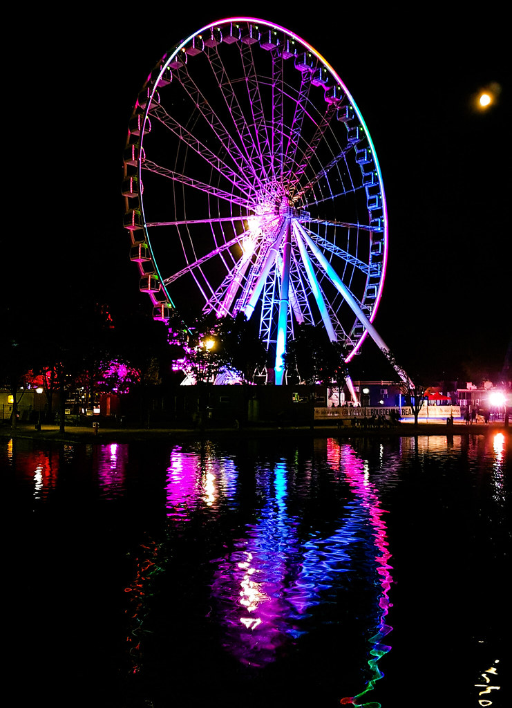 Ferris Wheel lit up at night at the Old Port  You are