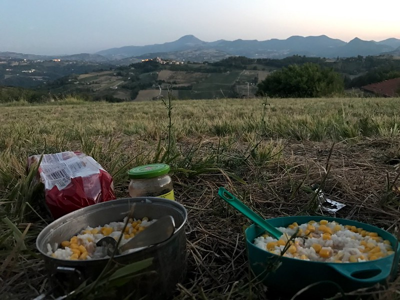italy cycling trip - having bush meal with great view to mountains