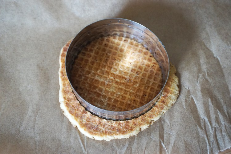 Gluten free Dutch waffles (stroopwafels) making process | trimming the edges of the waffles with a cookie cutter