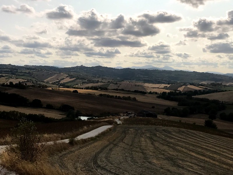 italy cycling trip - Fields, hills, and wide sky in marche italy
