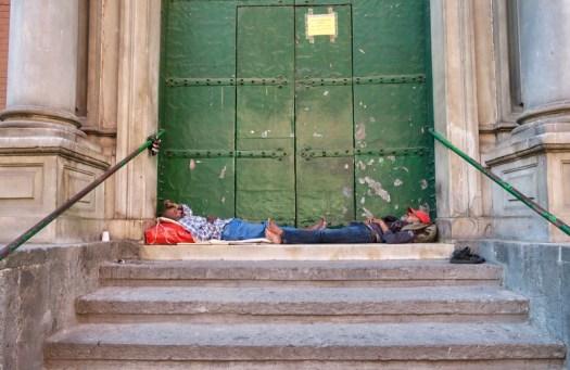 Homeless Men in front of Green Door