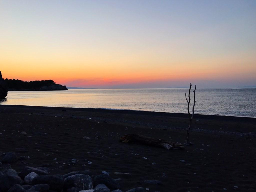 amazing sunset in aegean sea from desolate beach in north evia vlachia